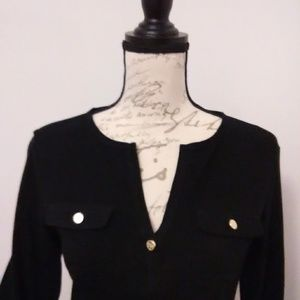 Black top with gold accent buttons